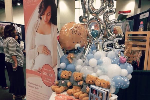 Teddy bear and Balloon on the table - Joy of Life Surrogacy