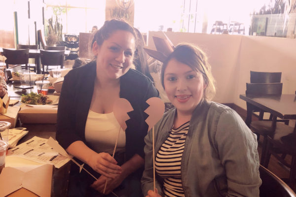 2 young women seating in the restaurant - Joy of Life Surrogacy