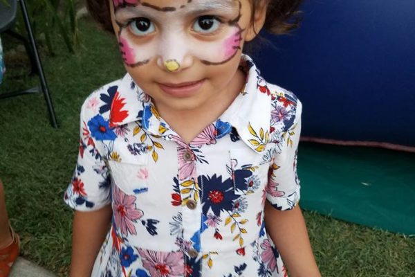 A little girl showing off her face painting - Joy of Life Surrogacy