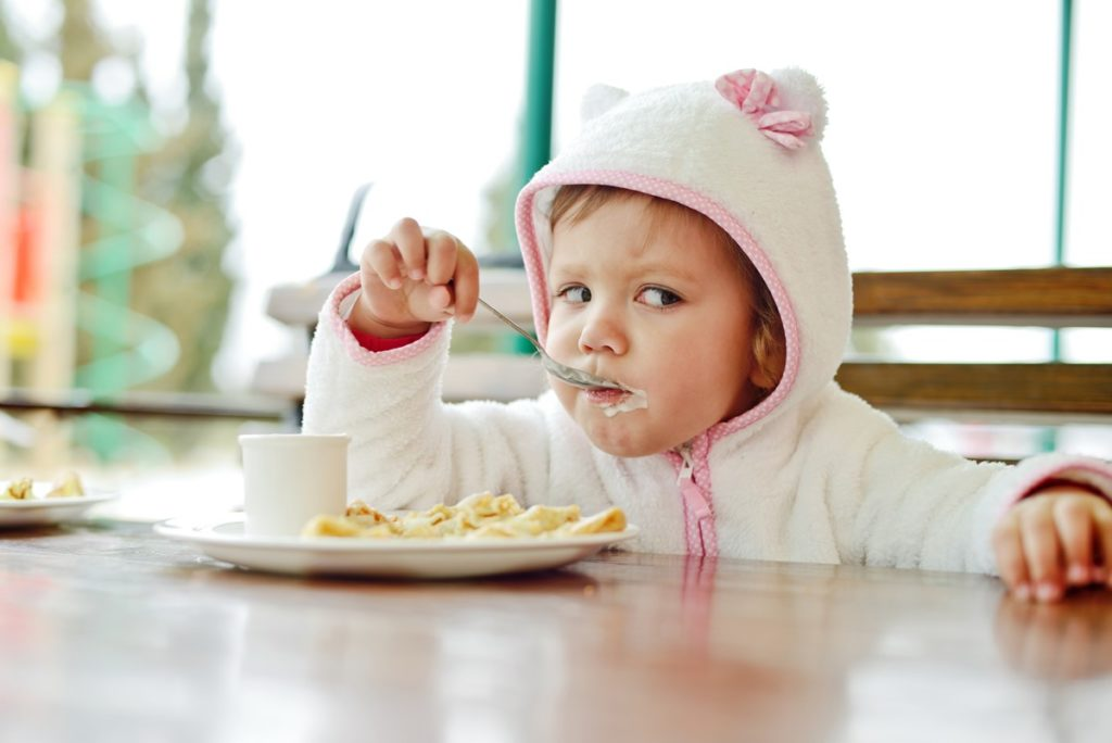 There is a cute baby was eating his breakfast - Joy of Lfie Surrogacy