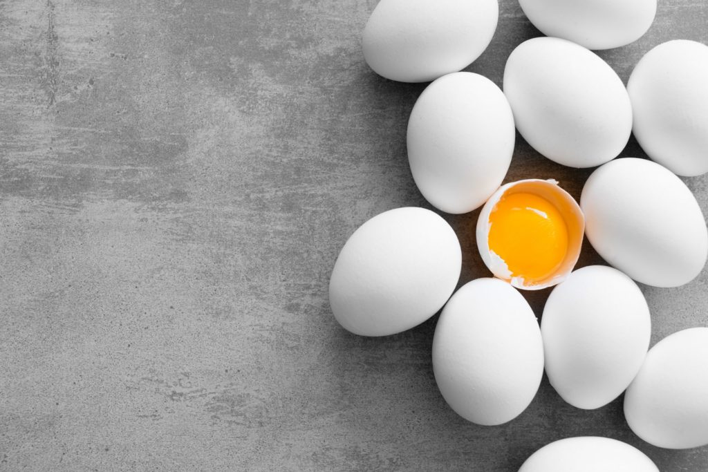 White eggs are laying on the ground - Joy of Life Surrogacy