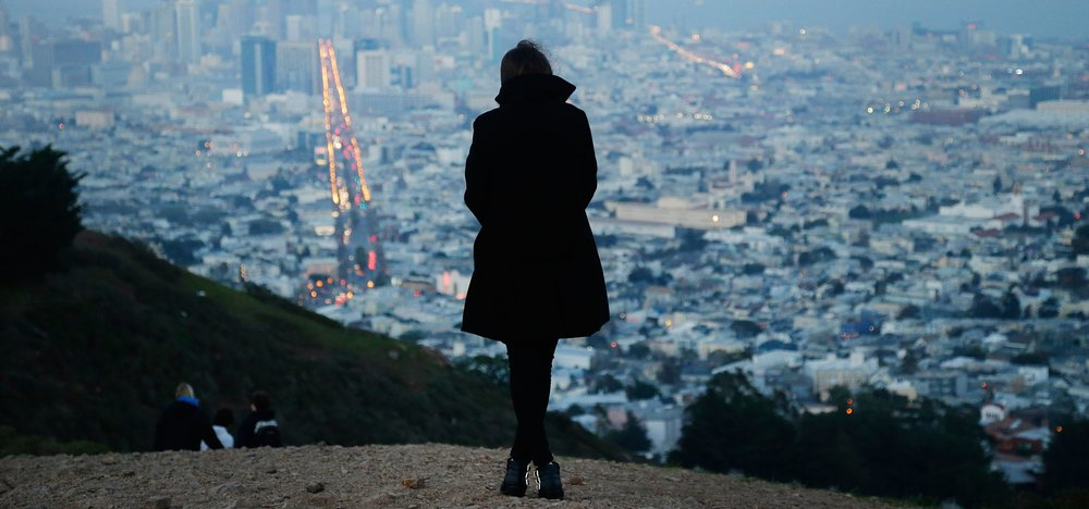 A Surrogate Mom Wearing a Black Coat and Standing on the Mountain - Joy of Life Surrogacy